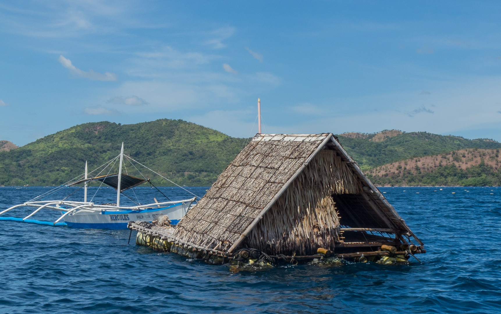 The hut watchmen of pearl farms. Learning diver, Philippines