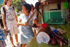 Locals and lechon, Philippines